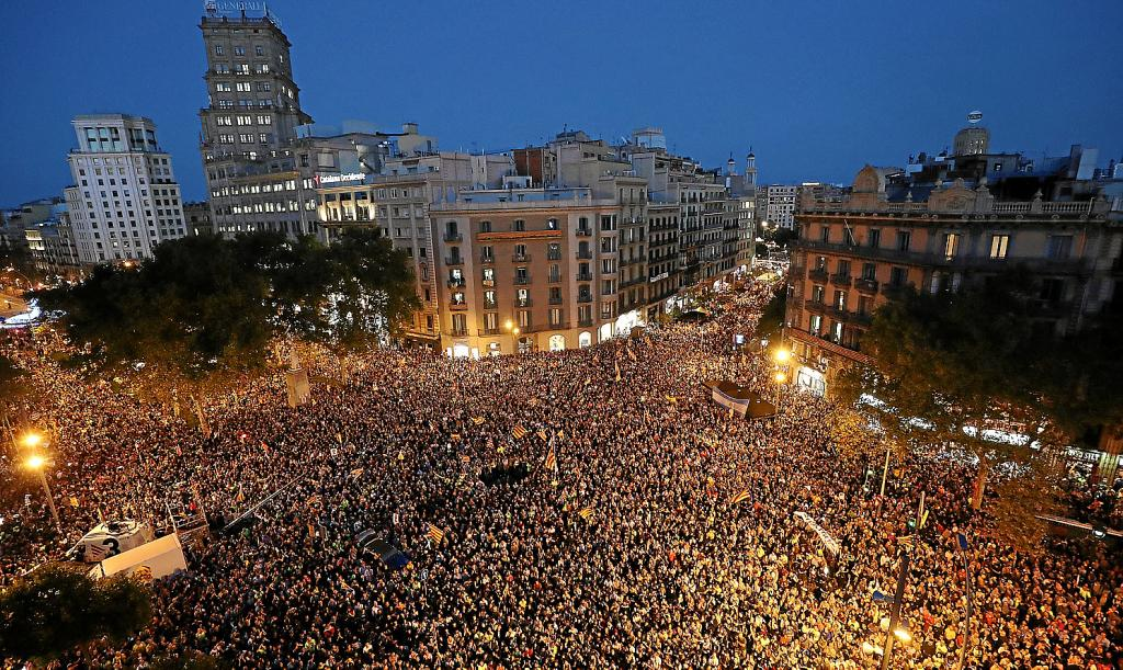 Protestors gather outside the Catalan region's economy ministry building during a raid by Spanish police on government offices,