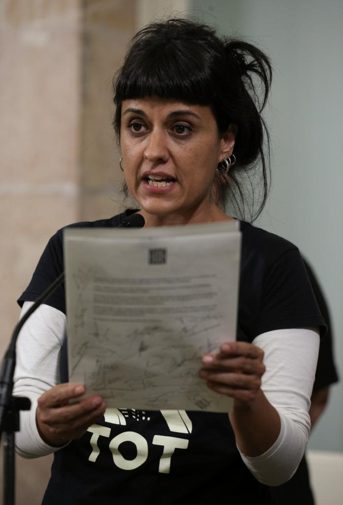 Leftist CUP party member Anna Gabriel holds up a declaration of independence at the Catalan regional parliament in Barcelona
