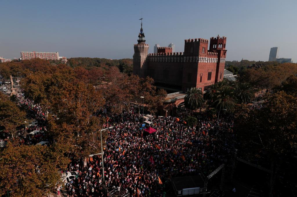 People gather near the Catalan regional parliament in Barcelona