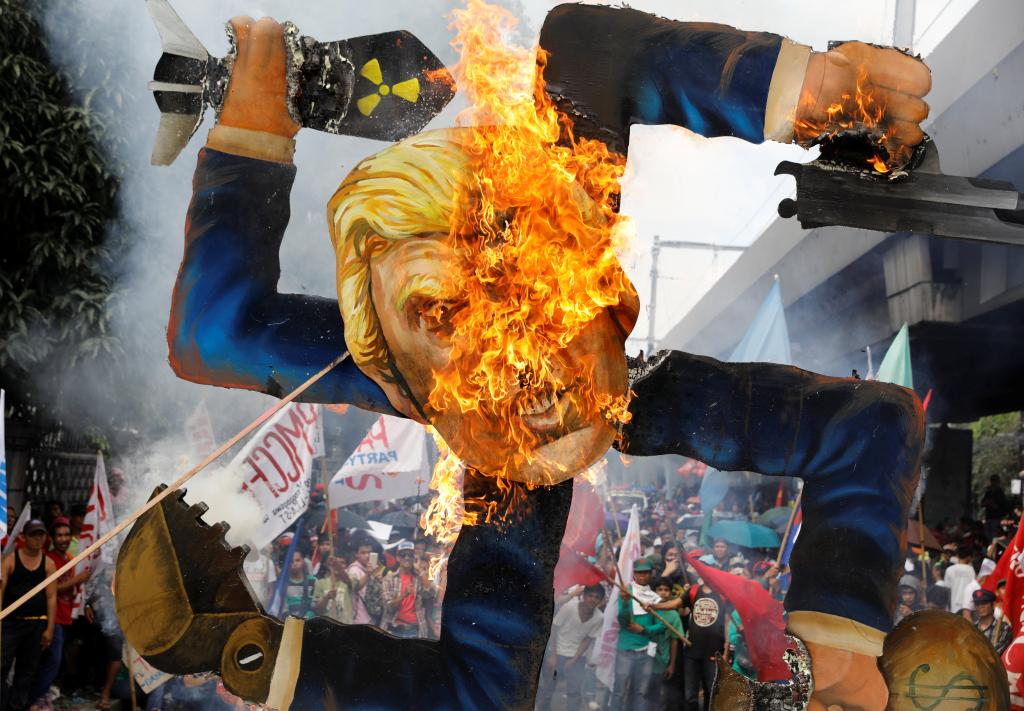 Protesters burn an effigy of U.S. President Trump, who is attending the ASEAN Summit and related meetings in Manila