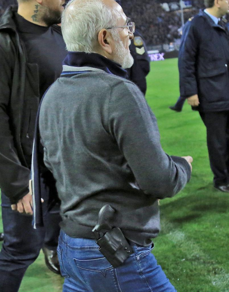 Russian-born Greek businessman and owner of PAOK Salonika, Ivan Savvides, pictured with what appears to be a gun in a holster, e