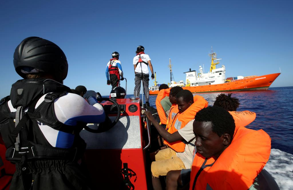 FILE PHOTO: Migrants on a rubber boat are rescued by the SOS Mediterranee organisation during a search and rescue (SAR) operatio