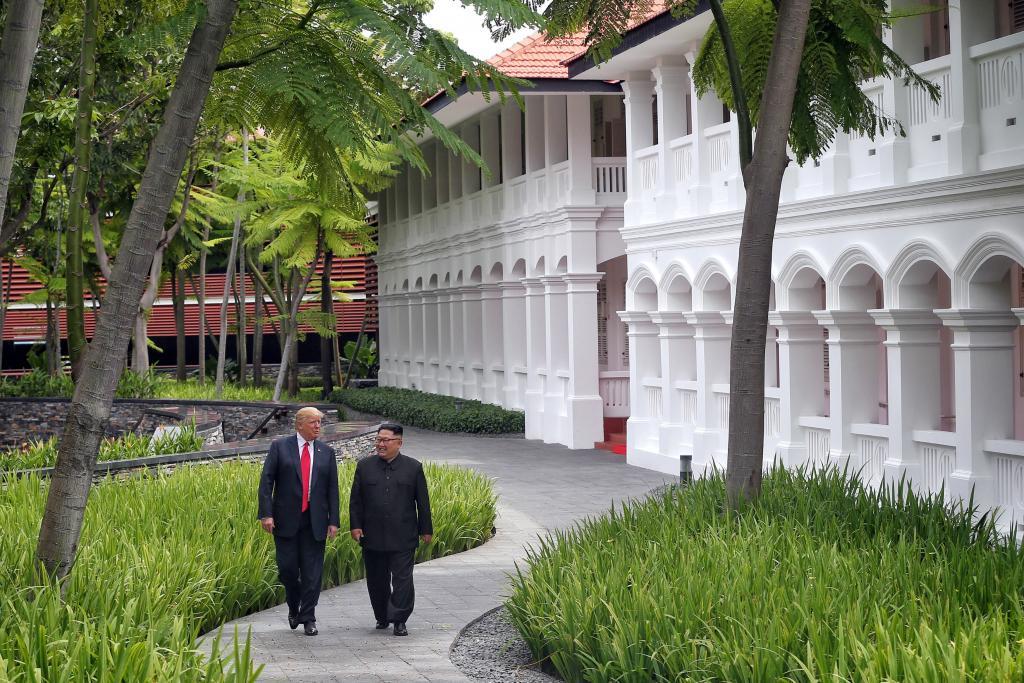 U.S. President Donald Trump walks with North Korean leader Kim Jong Un at the Capella Hotel on Sentosa island in Singapore