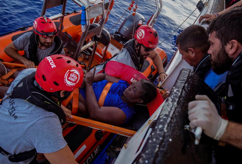 NBA Memphis player Marc Gasol and members of NGO Proactiva Open Arms rescue boat carry an African migrant in central Mediterrane