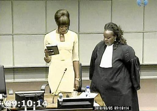 A frame grab shows British supermodel Naomi Campbell taking an oath before testifying at the war crimes trial of former Liberian
