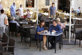 Britain's Prime Minister David Cameron and his wife Samantha sit at a cafe during a holiday in Majorca, Spain
