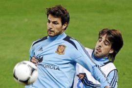 Spain's Fabregas and Etxebarria challenge for the ball during a training session in Madrid