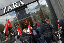 Demonstrators try to enter a Zara store during an anti-capitalism protest in Barcelona