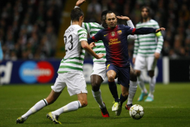 Barcelona's Andres Iniesta runs with the ball as Celtic's Victor Wanyama and Mikael Lustig challenge during their Champions Leag