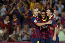Barcelona's Neymar, Messi and Iniesta celebrate a goal against Real Sociedad during their Spanish First division soccer league m