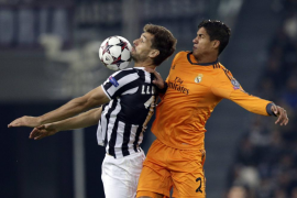 Juventus' Llorente jumps for the ball against Real Madrid's Varane during their Champions League soccer match at Juventus stadiu