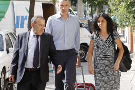 Naghemeh and Brett King, parents of Ashya King, walk before attending a news conference with their lawyer Fernandez in the Andal