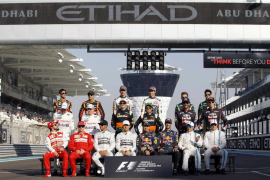 Formula One drivers pose for the end-of-season group photo before the start of the race at the Abu Dhabi F1 Grand Prix at the Ya