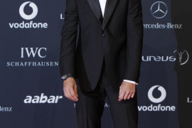 Tennis player Nadal poses as he arrives on the red carpet for the Laureus World Sports Awards in Abu Dhabi
