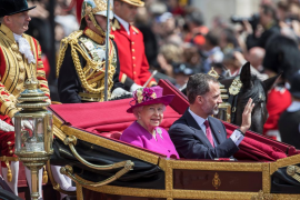 Britain's Queen Elizabeth rides in a carriage with Spain's King Felipe, following a ceremonial welcome in central London