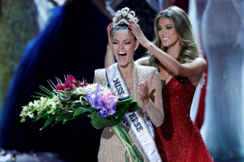 Miss South Africa Demi-Leigh Nel-Peters reacts as she is crowned by Miss Universe 2016 Iris Mittenaere during the 66th Miss Univ