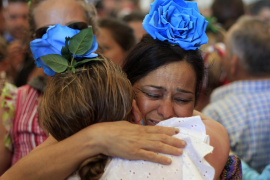 Pilgrims cry after finishing the procession of the Virgin of El Rocio in the shrine of El Rocio in the province of Huelva