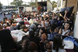 Chileans arrive with donations of clothing and food for earthquake survivors in Santiago