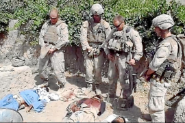 Video grab taken from an undated YouTube video showing what is believed to be US Marines urinating on the bodies of dead Taliban