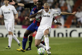 Real Madrid's Pepe and CSKA Moscow's Doumbia fight for the ball during their Champions League round of 16 second leg soccer matc