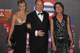 Prince Albert II of Monaco, his wife Princess Charlene and Princess Caroline of Hanover arrive to attend the Rose Ball in Monte