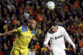 Real Madrid's Higuain and APOEL's Paulo Jorge go for a high ball during their Champions League quarter-final first leg soccer ma