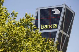 Caja Madrid and Bankia logos are seen at their headquarters tower in Madrid